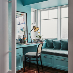 Transitional study room in Newcastle - Maitland with blue walls, medium hardwood floors, no fireplace, a built-in desk and brown floor.