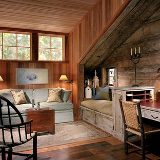 Study room - large traditional built-in desk medium tone wood floor study room idea in Philadelphia with no fireplace