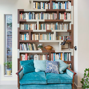 Inspiration for a mid-sized gray floor home office library remodel in London with beige walls