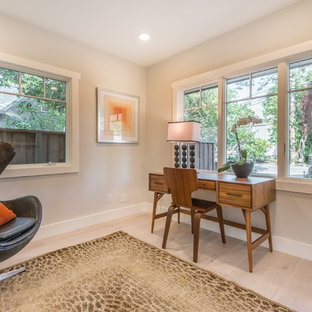 Trendy freestanding desk light wood floor home office photo in San Francisco with beige walls and no fireplace