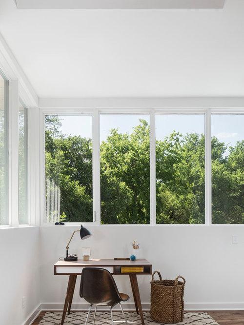 example of a trendy freestanding desk dark wood floor and brown floor home office design in - White Home Interior