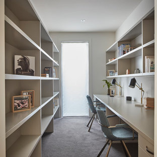 This Is An Example Of A Contemporary Home Office In Melbourne With White  Walls, Carpet