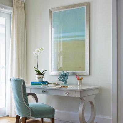 Beach style freestanding desk medium tone wood floor study room photo in San Diego with beige walls