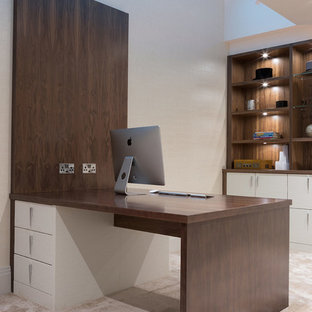 Inspiration for a large contemporary study in Hertfordshire with white walls, carpet, a built-in desk and white floors.