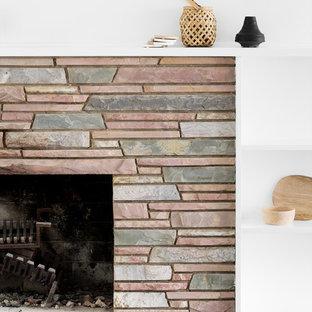Idées déco pour un bureau scandinave de taille moyenne avec un mur blanc, un sol en bois foncé, un bureau intégré, une cheminée standard, un manteau de cheminée en pierre et un sol marron.