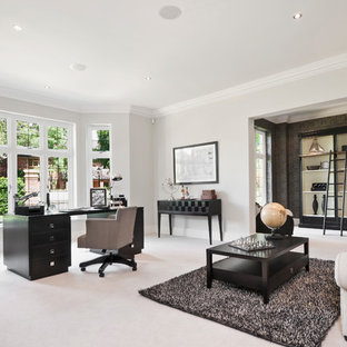 Inspiration for a contemporary freestanding desk home office remodel in Berkshire with gray walls