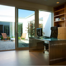 Modern Home Office by Camery Hensley Construction, Ltd