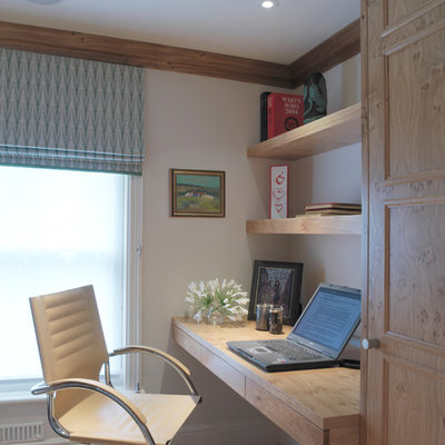 Inspiration for a cottage built-in desk home office remodel in London