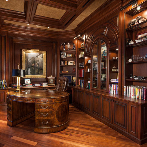 Inspiration for a timeless freestanding desk medium tone wood floor study  room remodel in Miami with