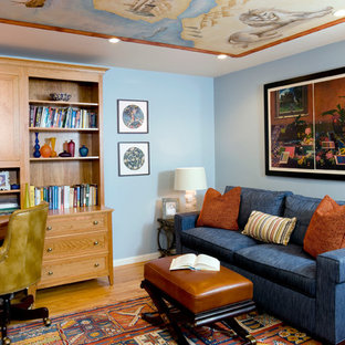 Example of a classic built-in desk medium tone wood floor home office design in Boston with blue walls