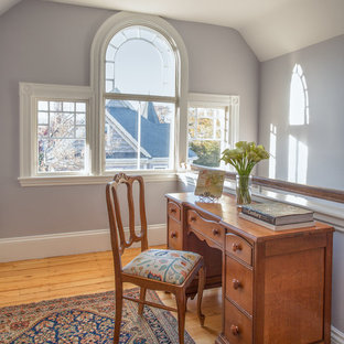 Inspiration for a small victorian study in Boston with purple walls, light hardwood flooring and a freestanding desk.