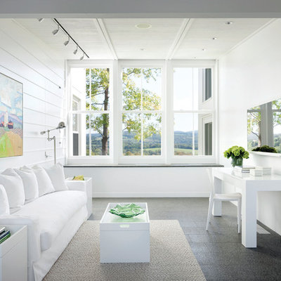 Example of a mid-sized country freestanding desk home office design in New York with white walls and no fireplace