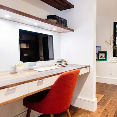 Study room - contemporary built-in desk dark wood floor and brown floor study room idea in San Francisco with white walls