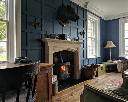 Bureau avec un poêle à bois et un mur bleu photos et idées déco