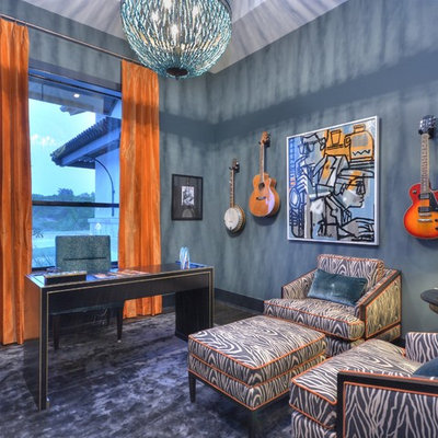 Inspiration for a transitional freestanding desk home office remodel in Austin with blue walls and no fireplace