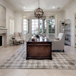 Tuscan freestanding desk beige floor study room photo in Los Angeles with white walls, a standard fireplace and a stone fireplace