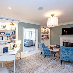 ロサンゼルスの大きいトランジショナルスタイルのおしゃれなホームオフィス・書斎 (ライブラリー、緑の壁、標準型暖炉、石材の暖炉まわり、自立型机、ベージュの床) の写真