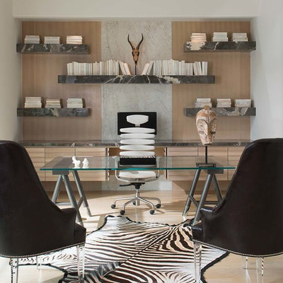 Example of a mid-sized trendy freestanding desk beige floor and light wood floor home office library design in Dallas with no fireplace and white walls