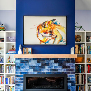 Inspiration for a medium sized classic home studio in Minneapolis with blue walls, vinyl flooring, a ribbon fireplace, a metal fireplace surround, a freestanding desk and brown floors.