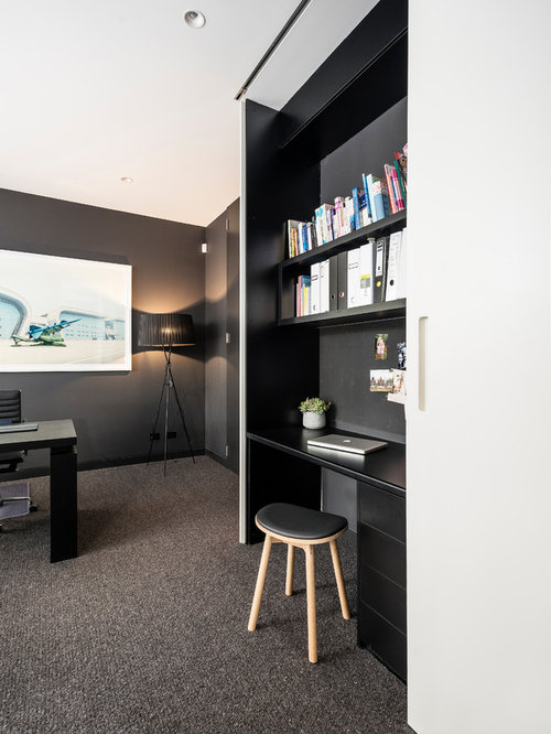 This Is An Example Of A Small Modern Study Room In Melbourne With Black  Walls,