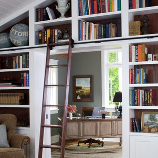 Inspiration for a timeless freestanding desk dark wood floor home office remodel in Grand Rapids with gray walls