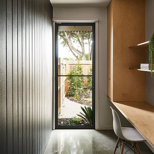 Design ideas for a beach style home office in Geelong with white walls, a built-in desk and grey floor.