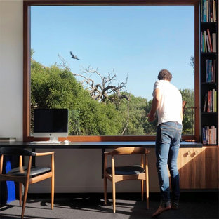 Study room - mid-sized contemporary built-in desk carpeted study room idea in Melbourne with white walls