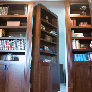 Example of a large classic carpeted and beige floor home office library design in Other with beige walls