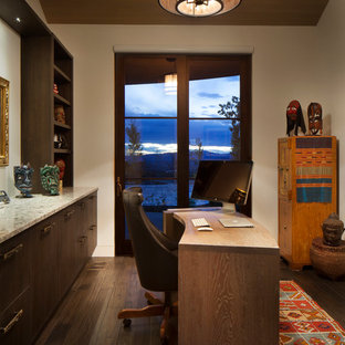 Study room - mid-sized transitional freestanding desk dark wood floor and brown floor study room idea in Denver with beige walls and no fireplace