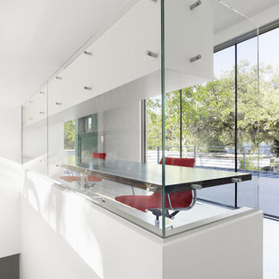 Inspiration for a modern home office remodel in Austin with white walls