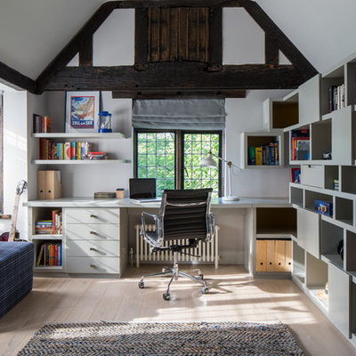 Inspiration for a cottage built-in desk light wood floor study room remodel in London with white walls