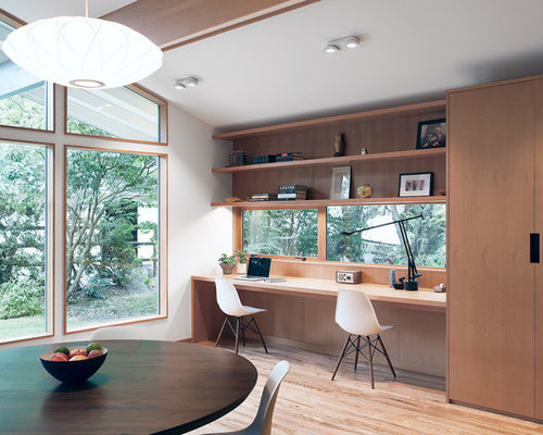 example of a small 1960s study room design in seattle with white walls light hardwood - Small Home Office Design Ideas