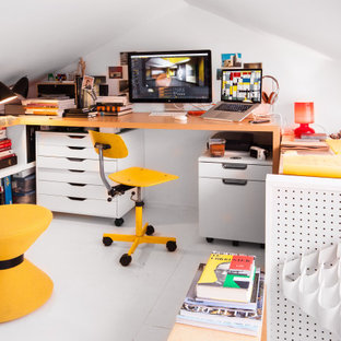 Small eclectic freestanding desk white floor home office photo in New York with white walls