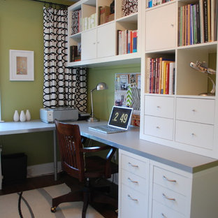 Example of a trendy built-in desk home office design in Toronto with green walls