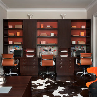 Study room - mid-sized contemporary built-in desk dark wood floor study room idea in Detroit with beige walls and no fireplace