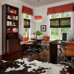Home office - transitional freestanding desk dark wood floor home office idea in Detroit with white walls