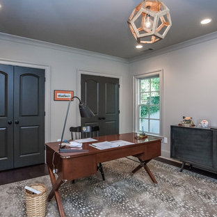 This is an example of a medium sized classic study in Atlanta with grey walls, dark hardwood flooring and a freestanding desk.