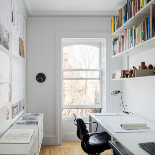Inspiration for a scandinavian freestanding desk light wood floor home office remodel in New York with white walls