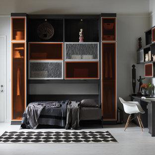 ニューヨークの大きいコンテンポラリースタイルのおしゃれな書斎 (白い壁、クッションフロア、造り付け机、暖炉なし、グレーの床) の写真