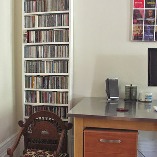 Photo of a mid-sized asian home studio in New York with white walls, medium hardwood floors and a freestanding desk.