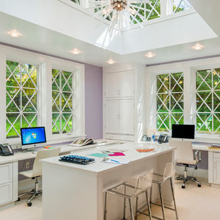 Design ideas for a medium sized traditional home office in Philadelphia with purple walls, carpet and a built-in desk.