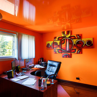 Example of a trendy home office design in Chicago with orange walls
