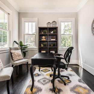 Cottage freestanding desk dark wood floor study room photo in Charlotte with gray walls