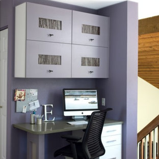 This is an example of a contemporary home office and library in Denver with purple walls.