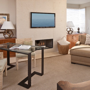 Example of a trendy freestanding desk home office design in Los Angeles with beige walls and a ribbon fireplace