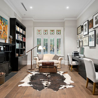 Design ideas for a transitional home office in Melbourne with grey walls, dark hardwood floors, no fireplace and a freestanding desk.