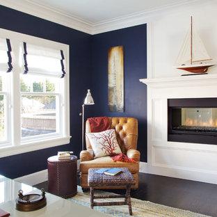 Inspiration för ett stort maritimt arbetsrum, med blå väggar, mörkt trägolv, en dubbelsidig öppen spis, en spiselkrans i trä och ett fristående skrivbord
