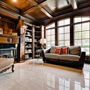 リトルロックのトラディショナルスタイルのおしゃれな書斎 (大理石の床、標準型暖炉、自立型机) の写真