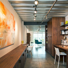 Industrial Home Office by David Robertson Design, LLC