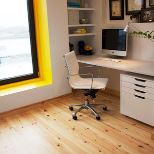 Example of a small minimalist home office design in Portland with white walls